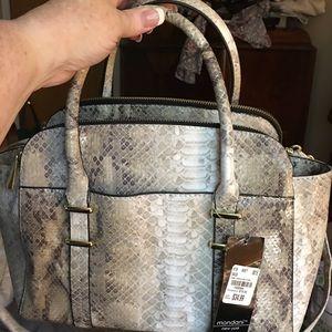 White and gray handbag